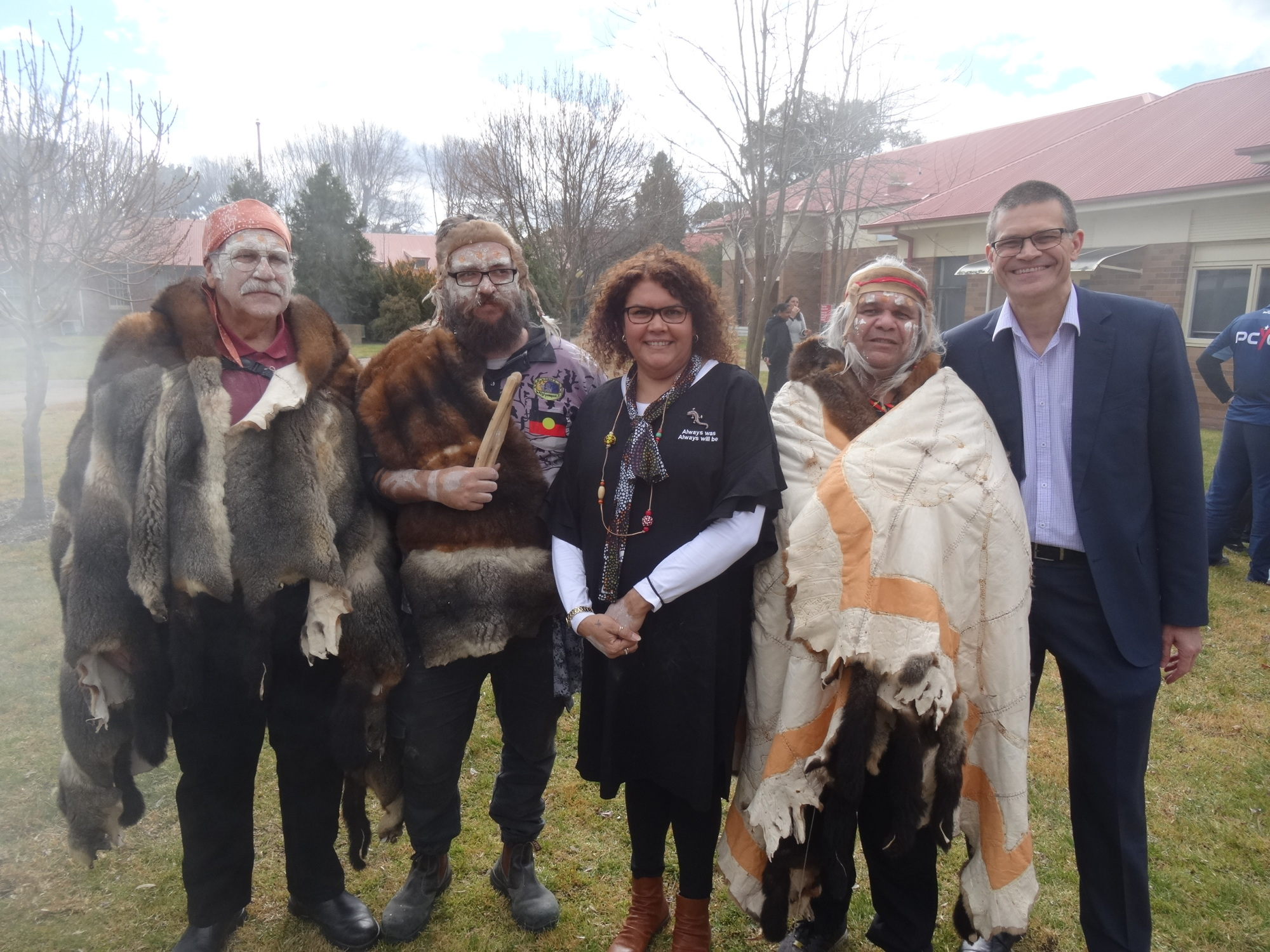This image shows Wiradyuri Elders Mallyan, Yanhadarrambal, Wirribee, and Dinawan Dyirribang with Charles Sturt Vice-Chancellor Professor Andrew Vann during the opening of a cultural hub for Wiradjuri elders on 4 July 2019. This photograph helps toillustrate the continuance of Wiradjuri culture and traditions more than 200 years after the founding of Bathurst in 1815.