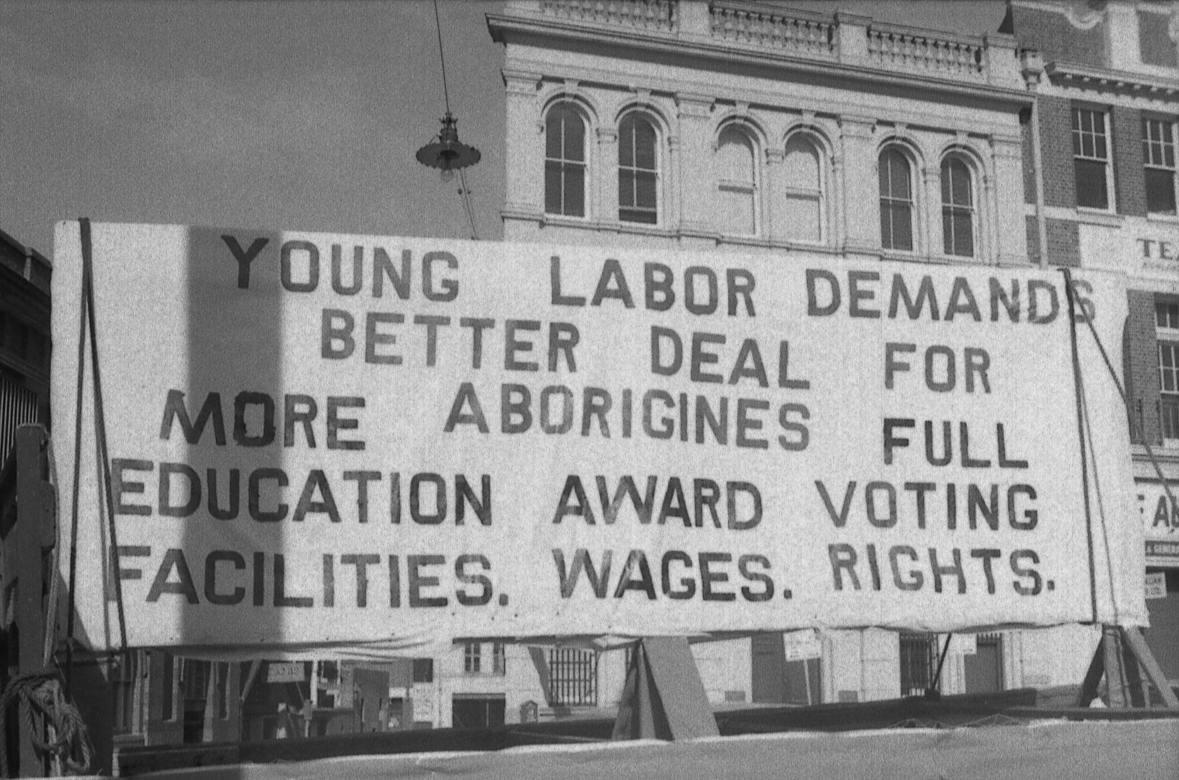 <p>Young Labor banner on Aboriginal rights, May Day procession, 1965</p>