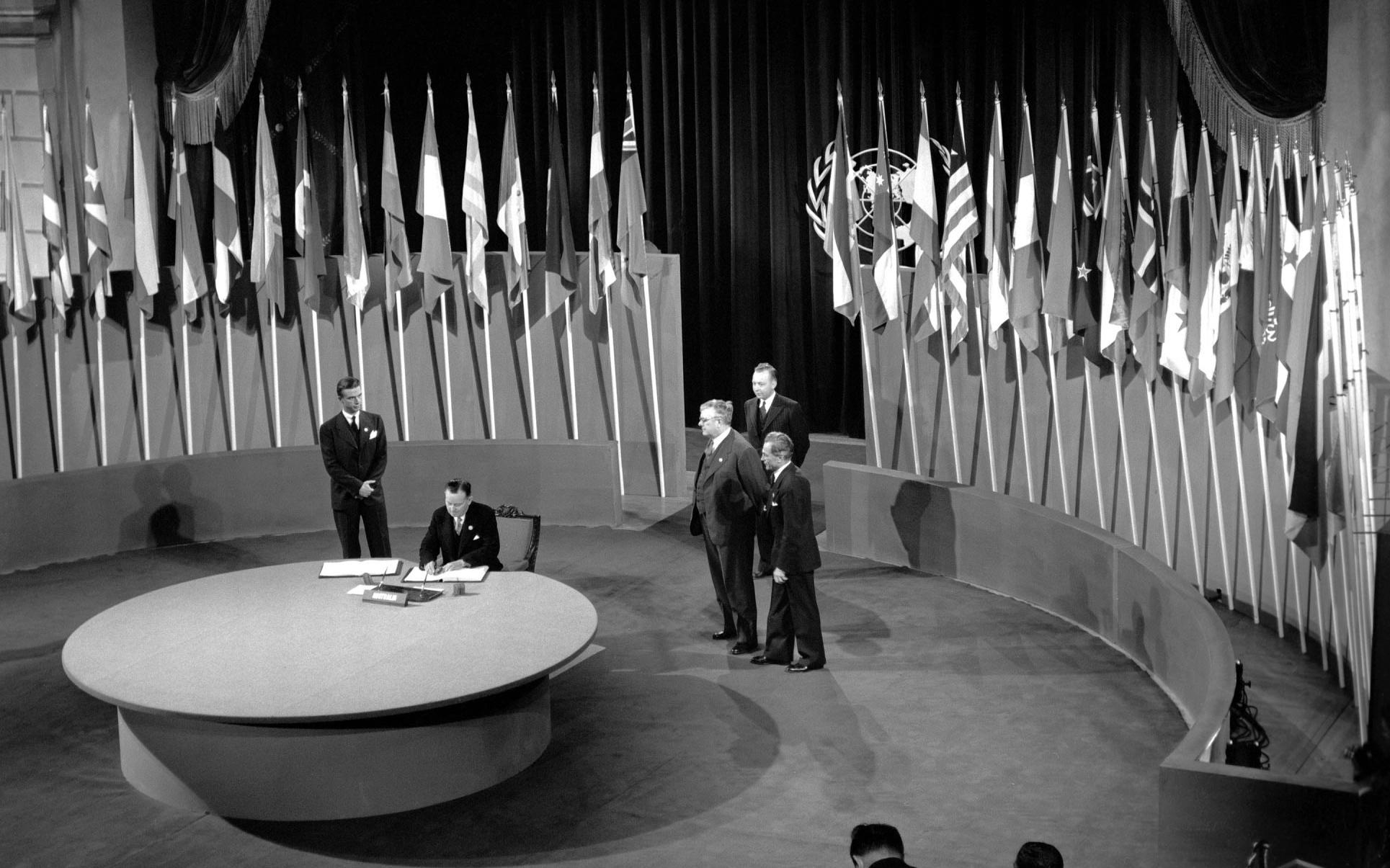 Francis Michael Forde, then Australia's Deputy Prime Minister, signing the UN Charter at a ceremony held in San Francisco, 26 June 1945